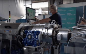 A Bausano Employee demonstrate an extrusion line